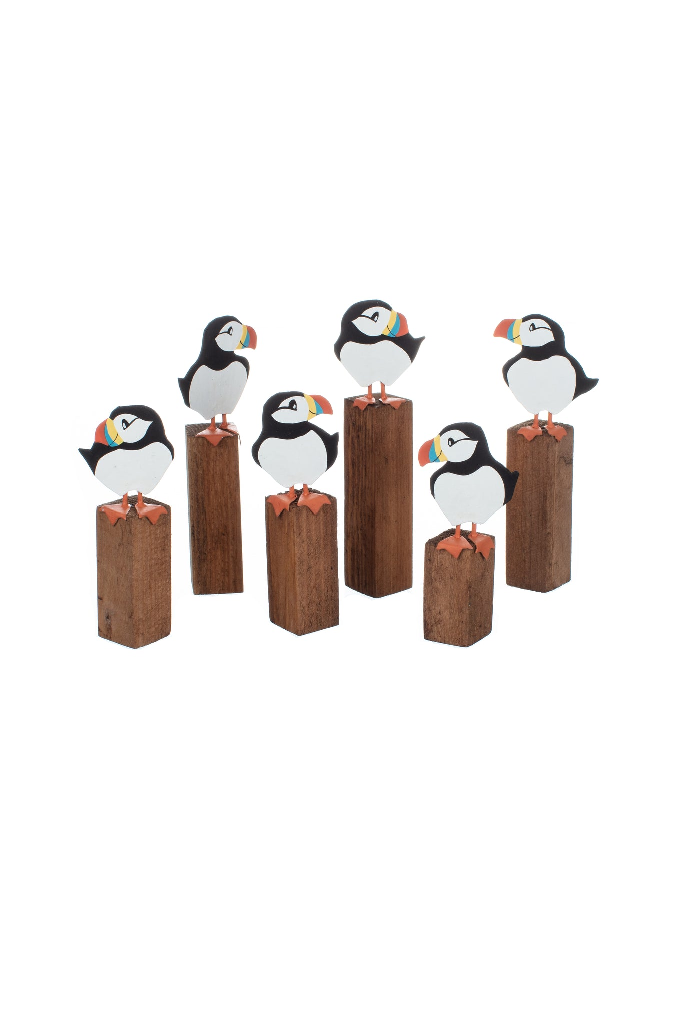Individual wooden Puffin on groyne