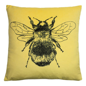 Yellow Bee cushion with patterned reverse.