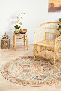 Delilah Traditional Bordered Round Rug in Rust