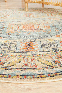 Skyla Aztec Patterned Round Rug in Light Blue & Rust