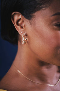 Ceejayeff diamond Marq hoop earring and circle Marq stud in yellow gold on a model
