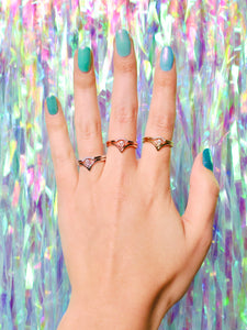 Ceejayeff curve ring and pear point ring in different gold tones on a hand