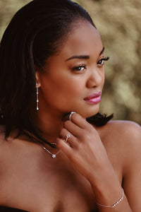 Ceejayeff Model wearing delicate gold and diamond jewelry