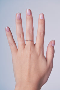 Ceejayeff diamond curve ring in rose gold on a hand