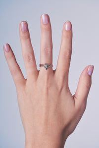 Ceejayeff curve ring and pear point gold and diamond ring on a hand