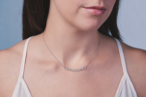 Ceejayeff diamond Marq strand bar necklace shown in white rose and yellow gold