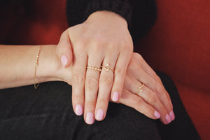 Ceejayeff Model wearing delicate gold and diamond rings