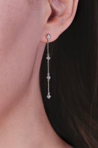 Ceejayeff long star find chain earring in white gold on an ear