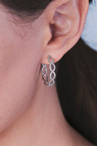 Ceejayeff diamond Marq hoop earring in white gold on a model