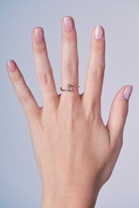 Ceejayeff pear Marq diamond bypass ring in rose gold on a hand