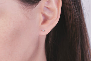 Ceejayeff single diamond Marq stud earring in rose gold on a model