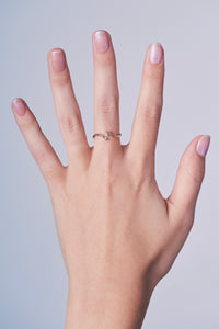 Ceejayeff star Marq diamond gold bypass ring on a hand
