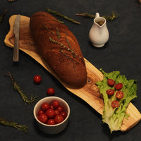 Loaf of bread and a salad placed on our Turkish Neem Platter