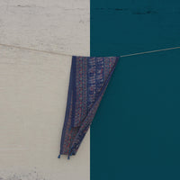 Our blue Floral Mul stole shot against a beige and blue wall.