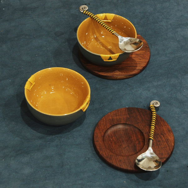 combination of ceramic, cane and sheesham to make an exotic soup bowl set with its matching platter and a spoon. available in two colors- mustard & grey and white