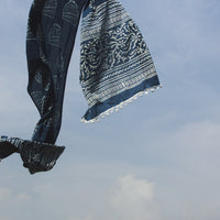 Our Indigo Beanie mul stole shot against a beautiful blue sky.
