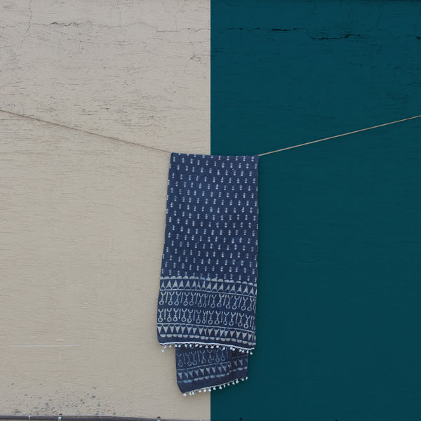 Our sustainable Indigo Mul (Desert) stole shot against a beautiful blue sky.