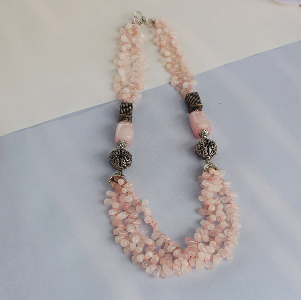 Women wearing our Roseate neck piece made with rose quartz stone