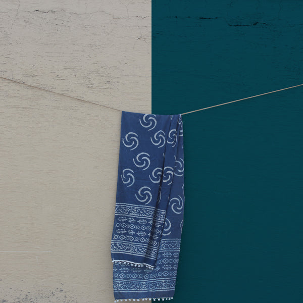 Our sustainable Indigo Mul (Chi) stole shot against a beautiful blue sky.