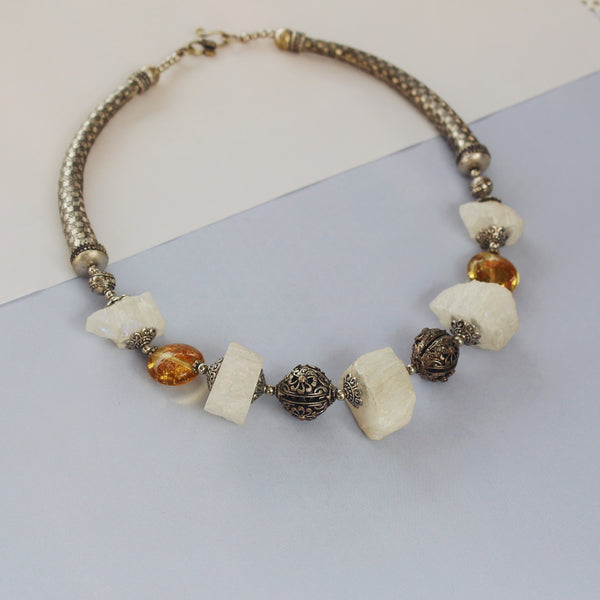 Women in  wearing Yogani neck piece made with Recycled Nickel and Unpolished Aura Quartz
