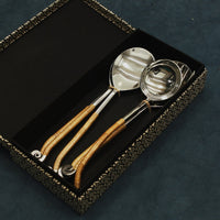 heavy duty stainless steel serving spoons wrapped with colourful and fun cane strings, placed in an exquisite kalamkari box available in two colours- Black & white and red & white