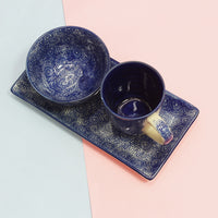 Our cobalt blue breakfast in bed set which contains a serving tray, a bowl and a mug.