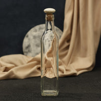 Exquisite water glass bottle with wooden knob as its cap