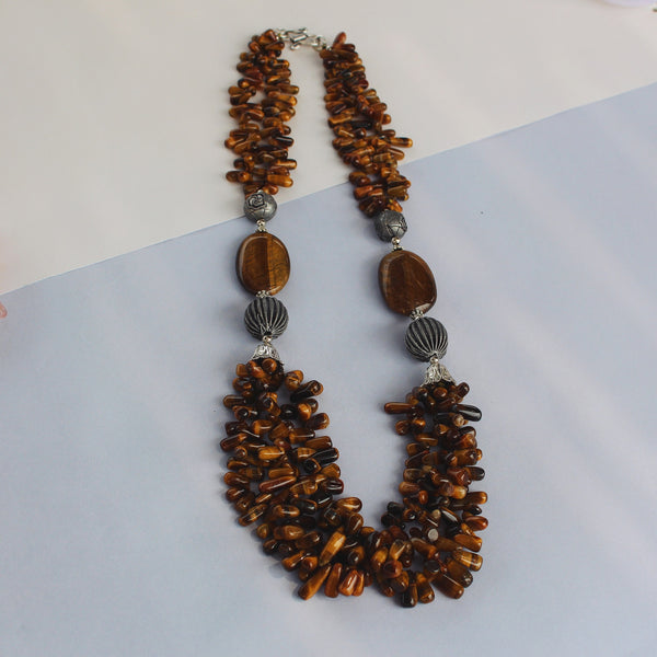 Women wearing our Sun Tanned neck piece made with tiger eye stone and recycled nickel.