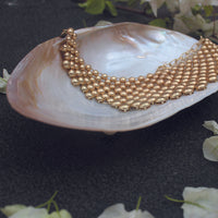 Pearl necklace on our Oyster Shell made with mother of pearl shell. Perfect for gifting for any occasion.