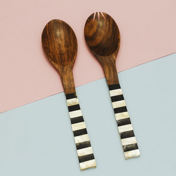 Set of two salad serving spoons that are a fuse of mother of pearl and rustic wood.