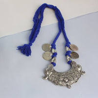 Silver neckpiece with elephants and coins for a traditional yet contemporary look.