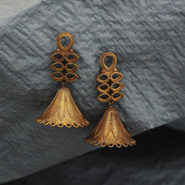 Our Temple Earrings  earrings made with unpolished brass placed on a grey background.