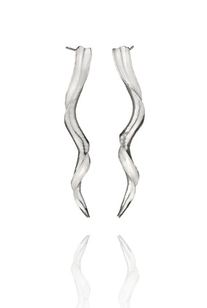 A pair of long, twisting silver earrings shaped like antelope horns