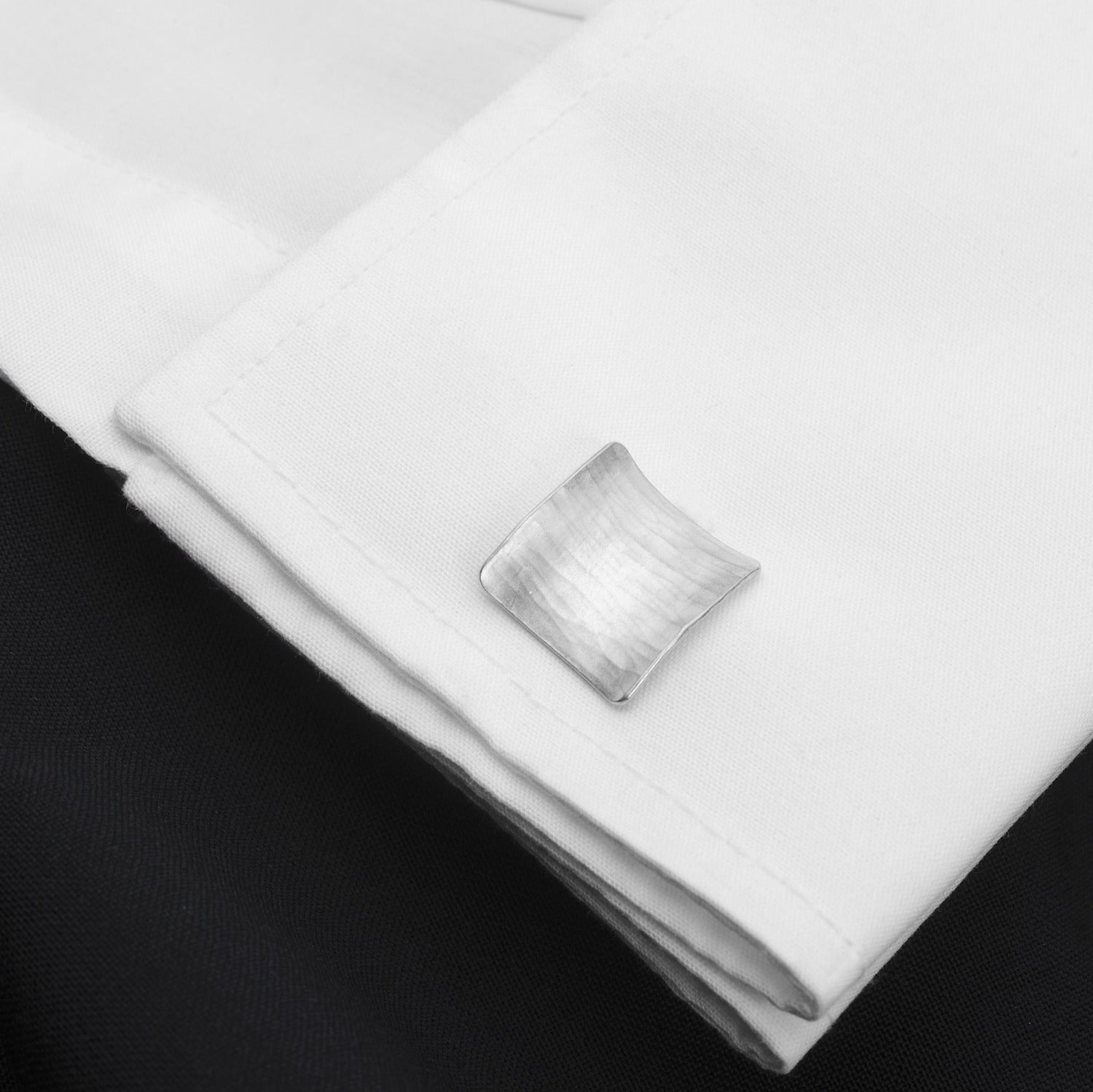 Square cufflink on a shirt cuff (not in wear)