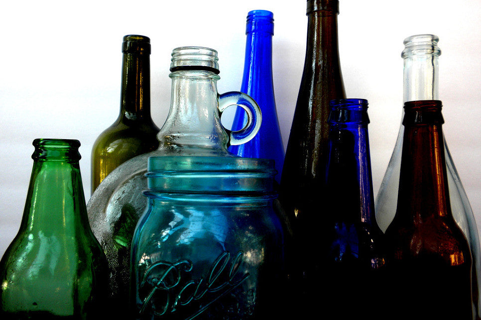 100% recycled bottles are sorted, sanitized, crushed and sifted into various size shards and frit. Each one of a kind night light is created