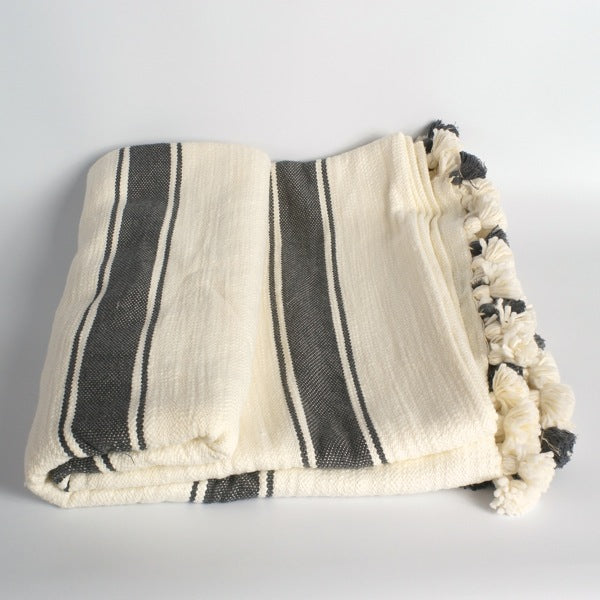 Woven blanket with tassels