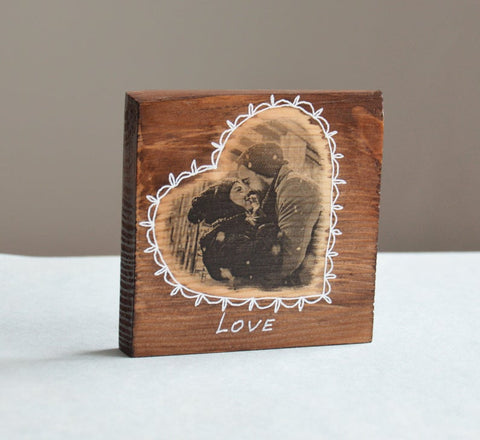 Photo  heart  on wooden plank