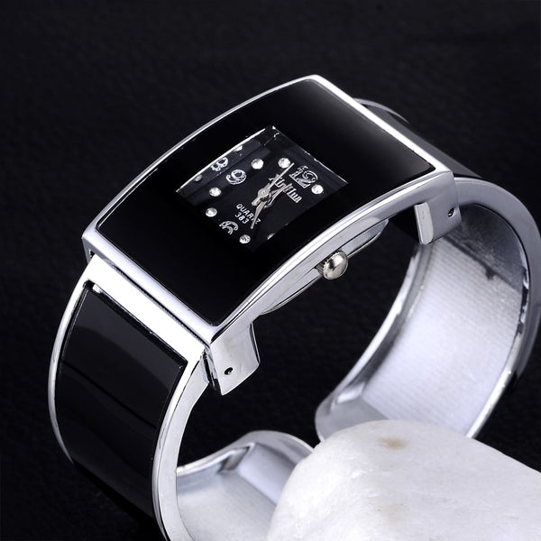 Xinhua White and Black Watches Women QuartzStainless Steel Bracelet Bangle