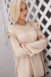 7/8 sleeve top with smocking and ruffle details