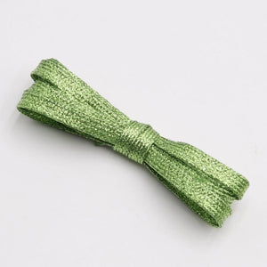 green sparkle shoelaces from the school fundraising shop. lots of colours and lengths and glitter on offer