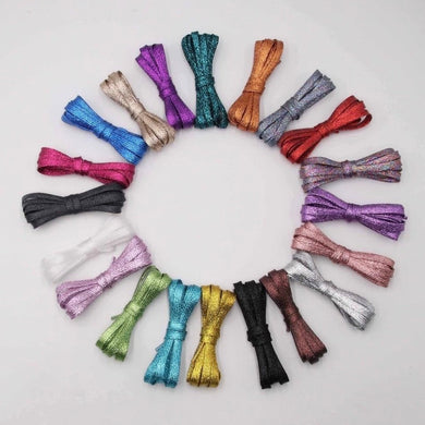 sparkle shoelaces from the school fundraising shop. lots of colours and lengths and glitter on offer