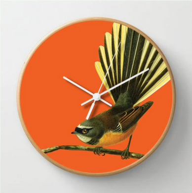 Bright Fantail Clock with an orange background and wooden frame.