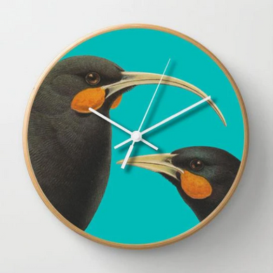 Bright Huia Clock on a blue background with a wooden frame.