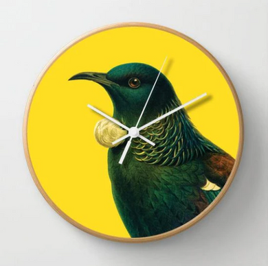 Bright Tui Clock on a yellow background with a wooden frame