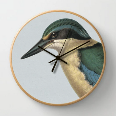 Hushed Blue Kingfisher Clock on a blue background with a wooden frame