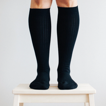Load image into Gallery viewer, Merino Wool Knee High Rib Socks - Black and these are womens