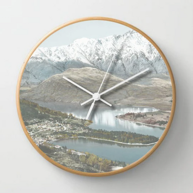 Queenstown Clock with wooden frame and glass front.