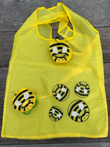 This generously sized bag folds away neatly into the bee pouch making it easy to take with you everyewhere.  Super fun and unique produce bag from The Beekeepers Honey and The School Fundraising Shop