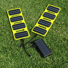 Load image into Gallery viewer, SunSaver 24K, 24,000mAh Solar Power Bank being charged with solar panels also for sale from the school fundraising shop