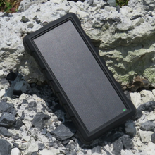 Load image into Gallery viewer, SunSaver 24K, 24,000mAh Solar Power Bank on rocks in the sun